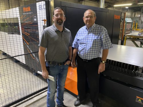 Owner & General Manager in front of Mazak Laser